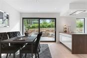 Spisestue/stue med åpen løsning til kjøkkenet