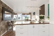 Kjøkken med åpen løsning til stue
