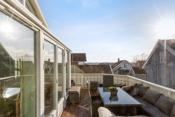 Fra en av boligens verandaer- her kan sol og utsikt nytes