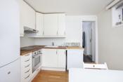 Kjøkken i kjellerdel som er definert som disponibelt rom med egen inngang